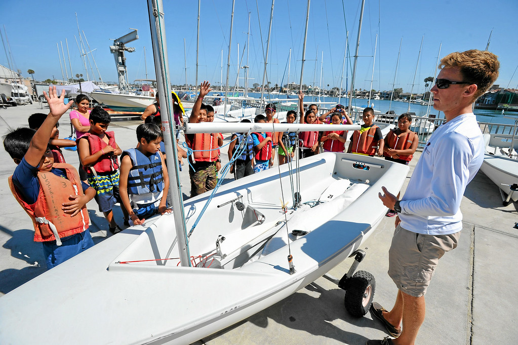. Sailing instructor Chris Segerblom, right, teaches a group of Huntington Beach school children from the El Viento Foundation\'s Reach program learn to sail in Long Beach, CA on Wednesday, July 30, 2014. The students, who come from a lower income neighborhood, were given the sailing lessons by staff at the U.S. Sailing Center. (Photo by Scott Varley, Daily Breeze)