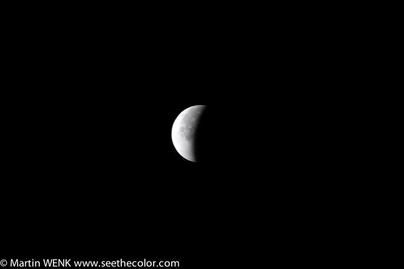 Receding shadow of the earth after the total lunar eclipse on December 11th, 2011. Seen from central Tokyo.