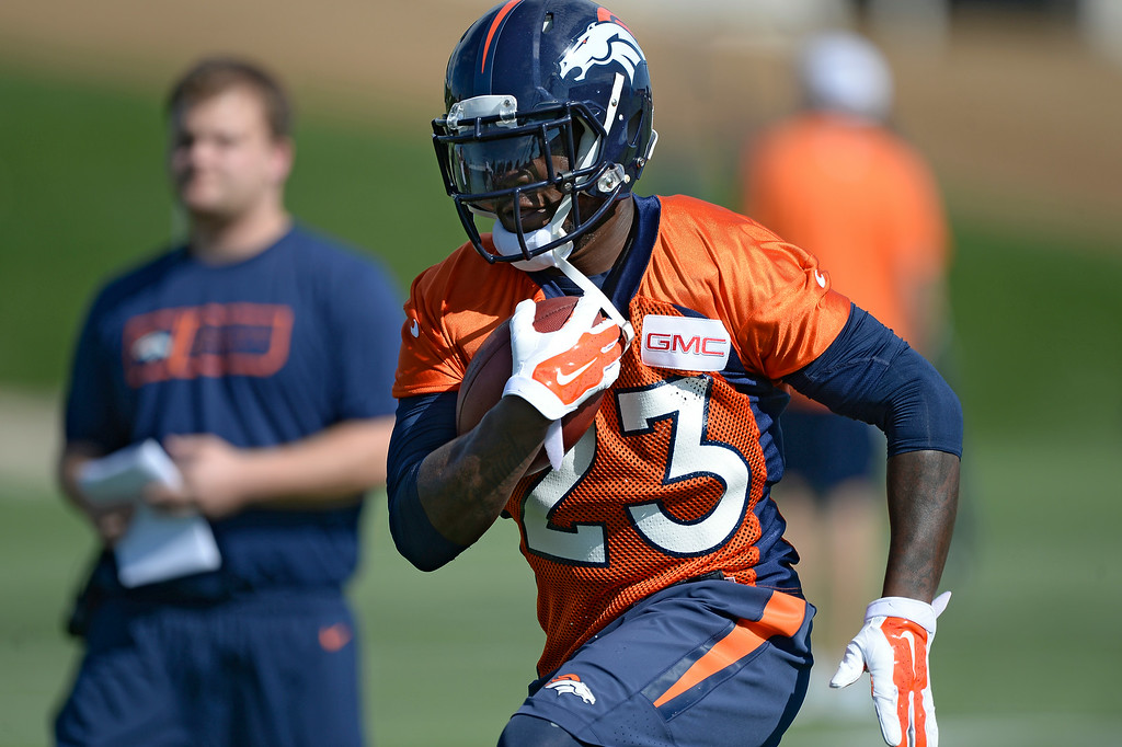 . Denver Broncos running back Ronnie Hillman (23) runs through drills during the first day of the Denver Broncos 2014 training camp July 24, 2014 at Dove Valley. (Photo by John Leyba/The Denver Post)