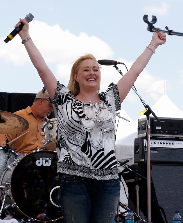 . In this June 5, 2008 file photo, country music artist Mindy McCready performs at the CMA Music Festival in Nashville, Tenn. McCready, who hit the top of the country charts before personal problems sidetracked her career, died Sunday, Feb. 17, 2013. She was 37. (AP Photo/Bill Waugh, File)