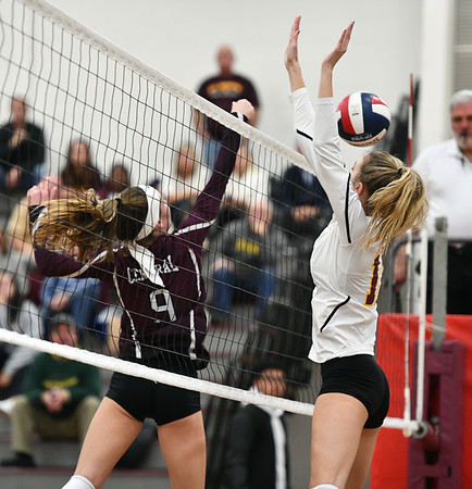 11/14/2019 Mike Orazzi | StaffrBristol Central High School's Ashleigh Clark (9) and St. Joseph High School's Ava Tuccio (12) during the Class L Second Round Girls Volleyball Tournament against Bristol Central at BCHS. r