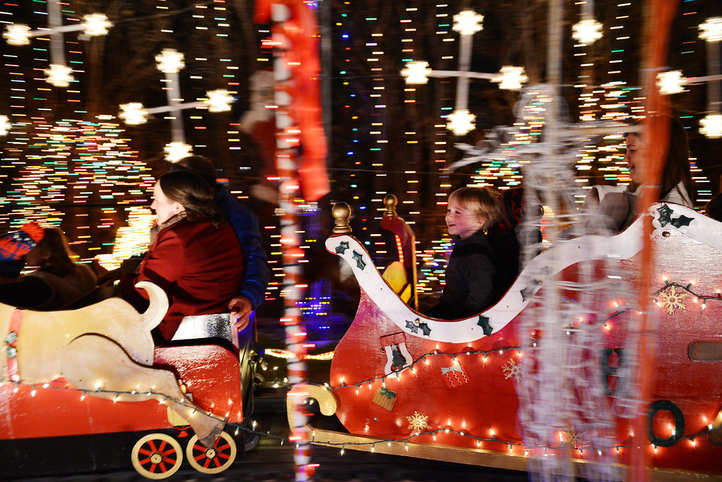 . Noah Perdue (right), 4, rides Joel Occhiuzzo\'s annual Holiday Express Riding Train in Richardson, Texas. Occhiuzzo has operated the 46-foot-long train in his backyard for 13 years, but due to the increased insurance cost, this Christmas will likely be his last year to operate the ride. (AP Photo/The Dallas Morning News, Rose Baca)