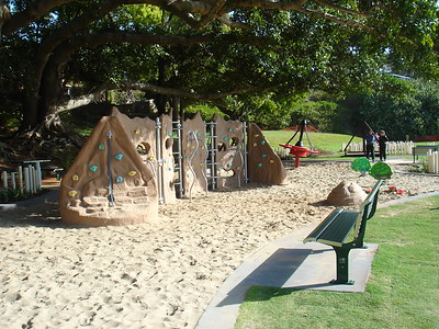 climbing wall in sandpit and bench seat