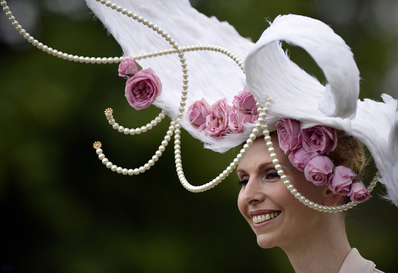 . TV presenter and conservationist Anneka Tanaka-Svenska wears a hat designed by Louis Mariette during the first day of Royal Ascot, in Berkshire, west of London, on June 18, 2013.  The five-day meeting is one of the highlights of the horse racing calendar. Horse racing has been held at the famous Berkshire course since 1711 and tradition is a hallmark of the meeting. Top hats and tails remain compulsory in parts of the course while a daily procession of horse-drawn carriages brings the Queen to the course.  ADRIAN DENNIS/AFP/Getty Images