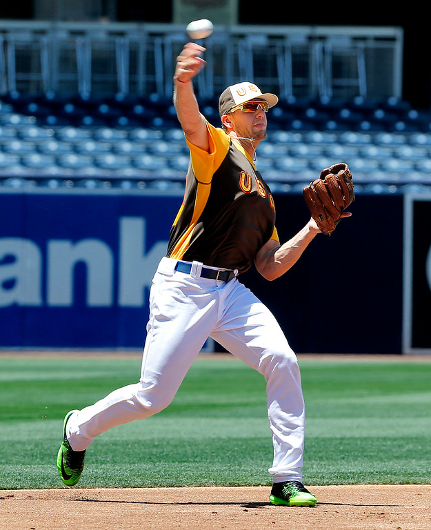 . U.S. Team\'s Hunter Dozier, of the Kansas City Royals, fields a ball prior to the All-Star Futures baseball game against the World team, Sunday, July 10, 2016, in San Diego. (AP Photo/Lenny Ignelzi)