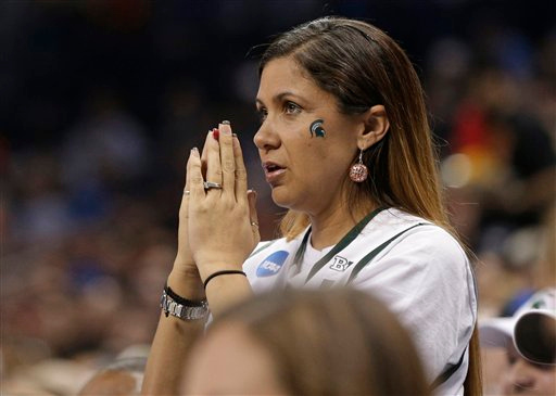 . A Michigan State fan watches the action during the second half of an NCAA tournament college basketball game against Virginia in the Round of 32 in Charlotte, N.C., Sunday, March 22, 2015. (AP Photo/Nell Redmond)