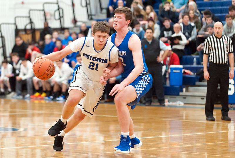 12/18/18  Wesley Bunnell | Staff  Southington basketball vs Glastonbury at Southington High School on Tuesday night. Billy Wadolowski (21) midcourt.