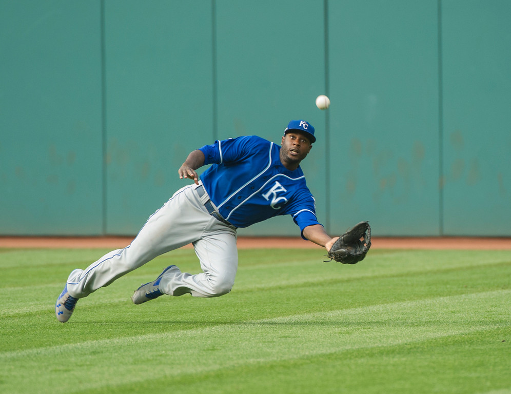 . Kansas City Royals\' Lorenzo Cain can\'t get to a ball that went for a single by Cleveland Indians\' Yandy Diaz during the third inning of a baseball game in Cleveland, Saturday, Sept. 16, 2017. (AP Photo/Phil Long)