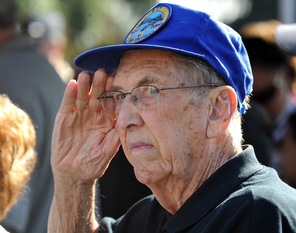 . WWII veteran Chuck Neilson, who was a tail gunner on a B-17, salutes as the American flag processes during the Veterans Day Celebration at El Monte City Hall on Monday November 11, 2013. Veterans are honored with speeches and music and a flag ceremony. (San Gabriel Valley Tribune/Staff Photo by Keith Durflinger)