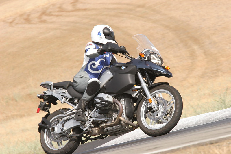 Cecilie on her BMW R1200GS at Thunderhill race circuit (California, USA) June 2007