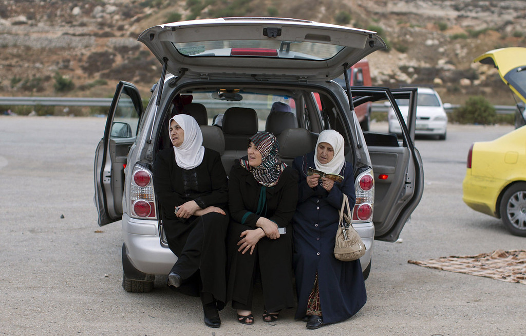 . Palestinian women from the Israeli occupied West Bank wait close to the Israeli military prison of Ofer, in the village of Betunia, for the release of Palestinian prisoners on  August 13, 2013. Israel is to release 26 veteran Palestinian prisoners ahead of a resumption of Middle East peace talks scheduled for August 14. The release of the prisoners, all but one of whom were jailed before the Palestinian Authority was formed in 1994, has been hailed by Palestinian negotiators but has incensed some Israeli officials.   AHMAD GHARABLI/AFP/Getty Images