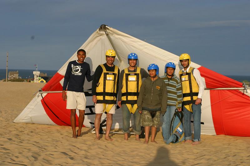 The hang gliding team posing.