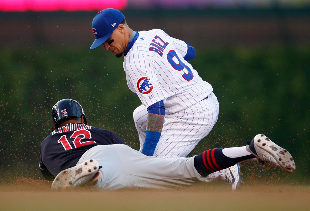 . Cleveland Indians\' Francisco Lindor (12) is tagged out at second by Chicago Cubs\' Javier Baez trying to stretch a hit into a double during the first inning of a baseball game Wednesday, May 23, 2018, in Chicago. (AP Photo/Jim Young)