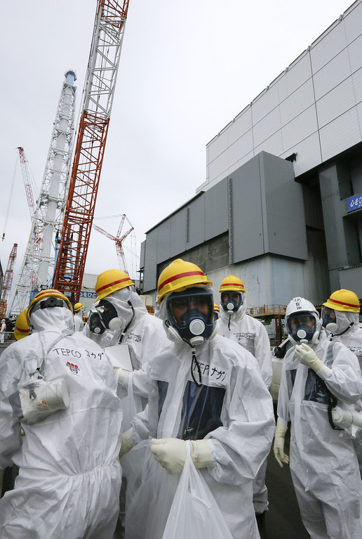 . Workers of the Tokyo Electric Power Co. (Tepco) and journalists visit the nuclear reactor four building of the Fukushima Dai-ichi nuclear power plant in Okuma, Fukushima Prefecture, Japan on November 7, 2013.    AFP PHOTO / / POOL KIMIMASA MAYAMA/AFP/Getty Images