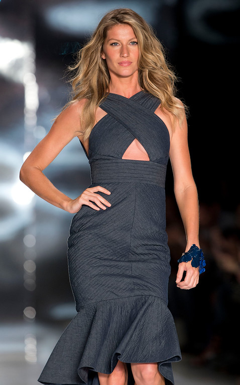 . Brazil\'s model Gisele Bundchen wears a creation from the Colcci Summer collection during Sao Paulo Fashion Week in Sao Paulo, Brazil, Wednesday, April 2, 2014. (AP Photo/Andre Penner)
