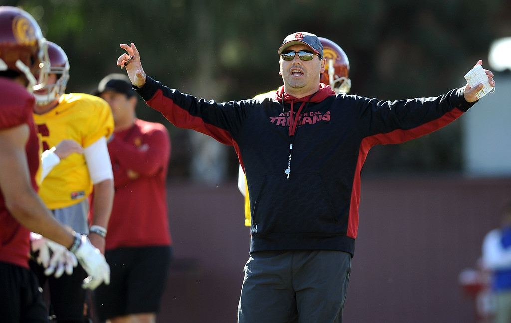 . USC football coach Steve Sarkisian directs players during spring practice at USC Monday, April 1, 2014. (Andy Holzman/Los Angeles Daily News)