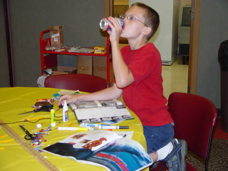 enjoying refreshments while working on his altered book.jpg