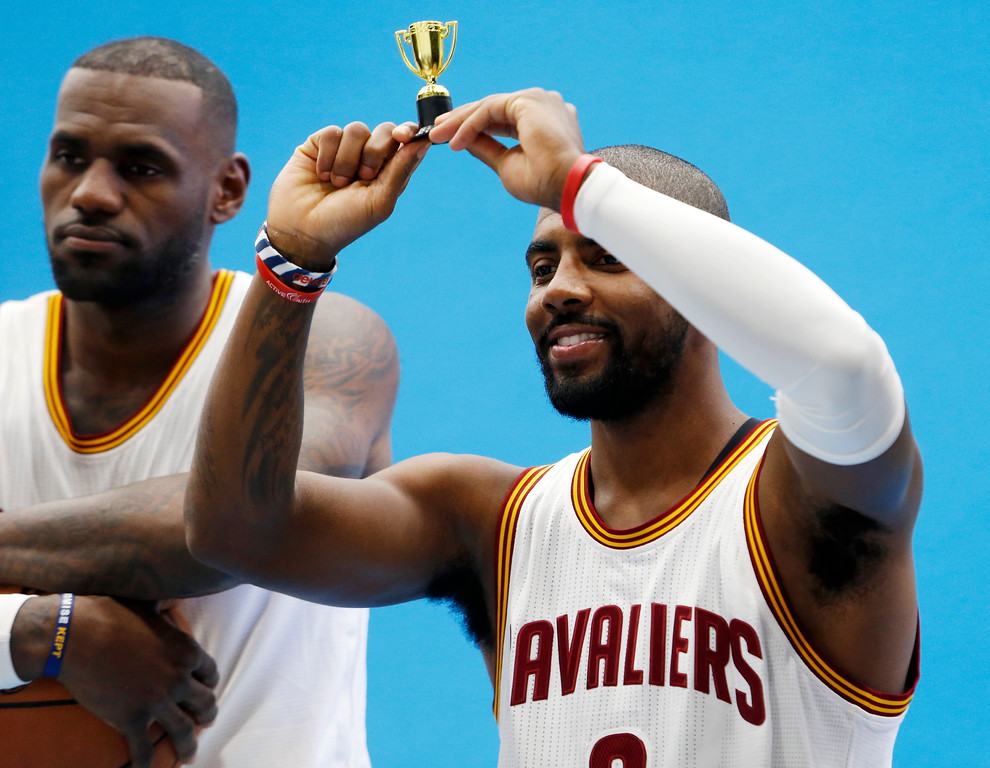 . Cleveland Cavaliers guard Kyrie Irving, right, and LeBron James during the NBA basketball team\'s media day, Monday, Sept. 26, 2016, in Independence, Ohio. (AP Photo/Ron Schwane)