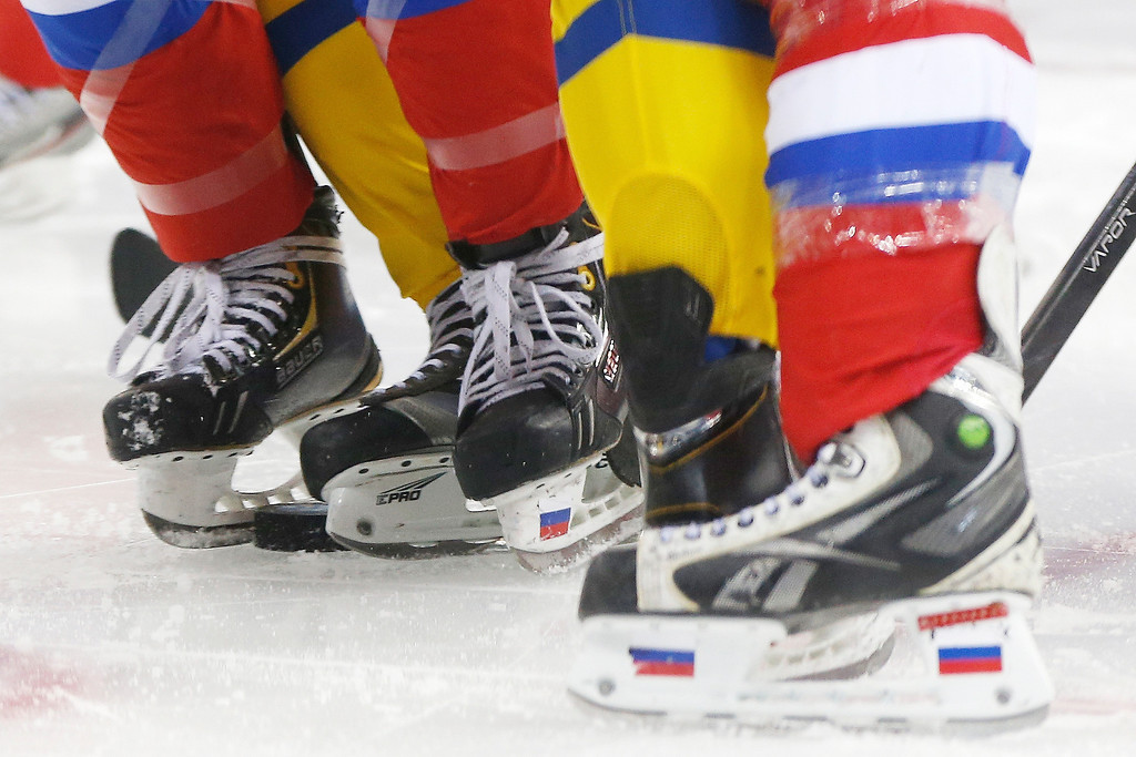 . Members of Team Russian and Team Sweden line up for a face off during the 2014 Winter Olympics women\'s ice hockey game at Shayba Arena, Thursday, Feb. 13, 2014, in Sochi, Russia. (AP Photo/Petr David Josek)