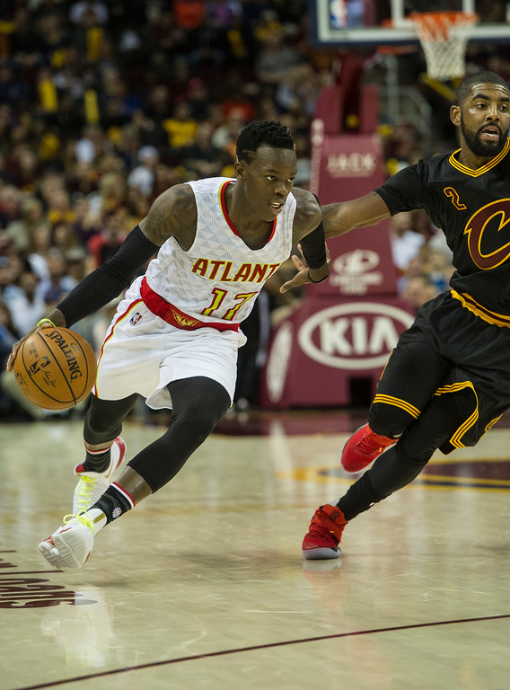 . Atlanta Hawks\' Dennis Schroder (17) drives to the basket as Cleveland Cavaliers\' Kyrie Irving (2) defe ends during the second half of an NBA basketball game in Cleveland, Tuesday, Nov. 8, 2016. The Hawks won 110-106. (AP Photo/Phil Long)