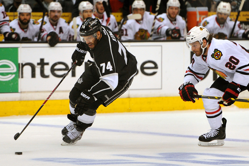 . The Kings\' Dwight King has a breakaway against the Blackhawks\' Brandon Saad during game six of the Western Conference Finals, Friday, May 30, 2014, at Staples Center. (Photo by Michael Owen Baker/Los Angeles Daily News)