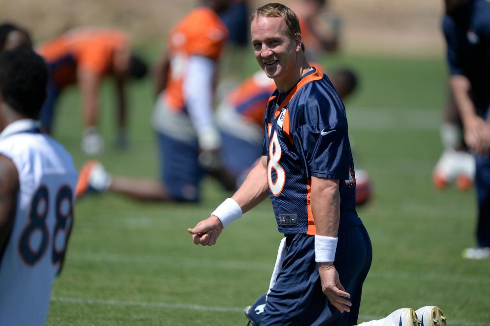 . Denver Broncos quarterback Peyton Manning (18) smiles during OTAs June 12, 2014 at Dove Valley. (Photo by John Leyba/The Denver Post)