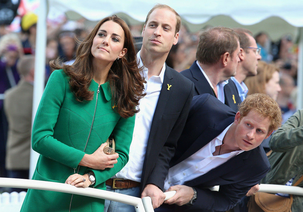 . Kate, Duchess of Cambridge, Prince William, Duke of Cambridge, centre, and Prince Harry, right, watch as Mark Cavendish watch for riders approaching the finish line of Stage 1 of the Tour De France Saturday, July 5, 2014 in Harrogate, England. The world\'s greatest cycle race, the Tour de France started for the first time in its history in Yorkshire this weekend. The event is expected to bring thousands of cycling fans to the region.  (AP Photo/Chris Jackson, Pool)