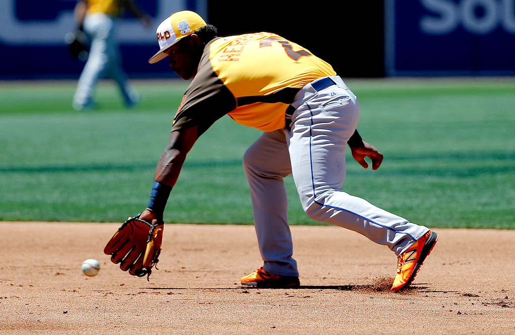 . World Team\'s Dilson Herrera, of the New York Mets, fields a ball prior to the All-Star Futures baseball game against the U.S. team, Sunday, July 10, 2016, in San Diego. (AP Photo/Lenny Ignelzi)