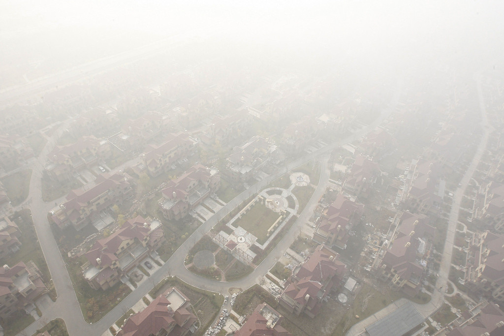 . Streets are seen under heavy smog in Harbin, northeast China\'s Heilongjiang province on October 22, 2013.    AFP PHOTOSTR/AFP/Getty Images
