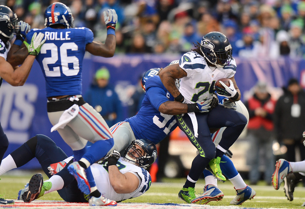 . Running back Marshawn Lynch #24 of the Seattle Seahawks carries the ball during the 2nd half of the Seattle Seahawks 23-0 win over the New York Giants at MetLife Stadium on December 15, 2013 in East Rutherford, New Jersey. (Photo by Ron Antonelli/Getty Images)