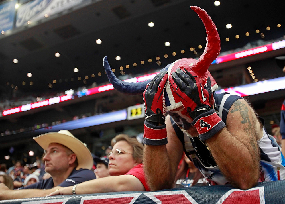 . Houston Texans fan Chris Lockwood buries his head in his hands as the Texans lose to the Minnesota Vikings during the fourth quarter of their NFL football game in Houston December 23, 2012. REUTERS/Richard Carson