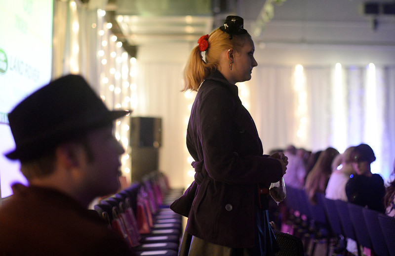 . Sara Eatherton  waits for the start of the second annual Westword Whiteout Fashion Show at the McNichols Building in Denver feature Denver designers on Thursday, January 30, 2014.  (Denver Post Photo by Cyrus McCrimmon)