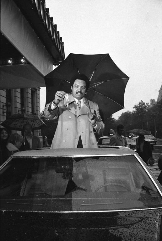 . New York Yankee Reggie Jackson stands through roof of new car he received Thursday Oct. 20, 1977 in New York as his reward from Sport Magazine for being named most valuable player in the 1977 World Series. Jackson says that he will give the car to his sister, Mrs. Tina Jones of Baltimore. (AP Photo/Marty Lederhandler)