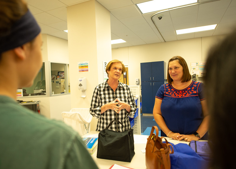 Dr. Mary Miller conducts her summer Health Assessment course in the mock hospital located on the second floor of Island Hall.
