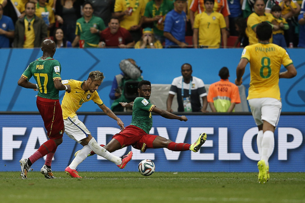 . Brazil\'s forward Neymar (2L) strikes to score a second goal during the Group A football match between Cameroon and Brazil at the Mane Garrincha National Stadium in Brasilia during the 2014 FIFA World Cup on June 23, 2014.  ADRIAN DENNIS/AFP/Getty Images