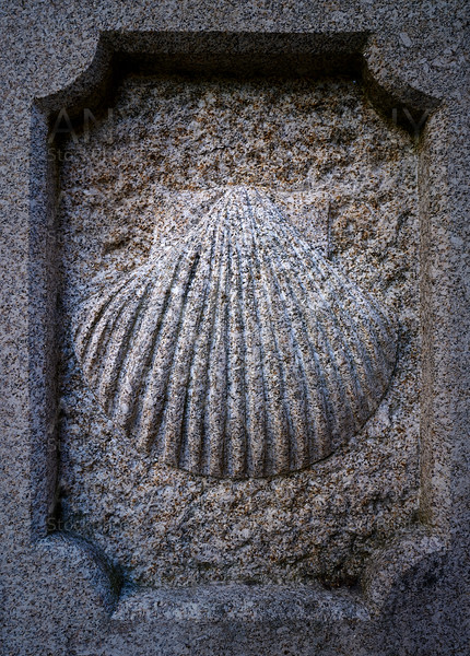 Camino Santiago stone shell sign in Combarro