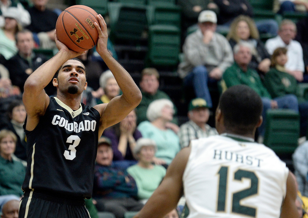 . University of Colorado\'s Xavier Talton shoots a three-pointer in front of Carlton Hurst during an NCAA game against Colorado State University on Tuesday, Dec. 3, 2013, at the Moby Arena in Fort Collins. Jeremy Papasso/ Camera