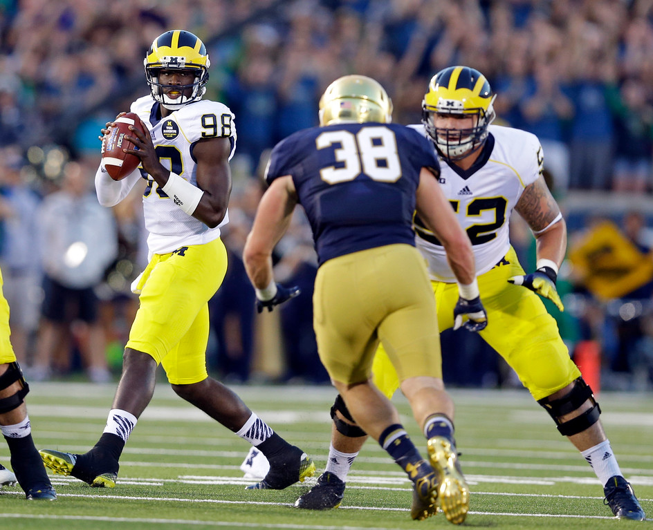 . Michigan quarterback Devin Gardner drops back to throw against Notre Dame during the first half of an NCAA college football game in South Bend, Ind., Saturday, Sept. 6, 2014. (AP Photo/Michael Conroy)