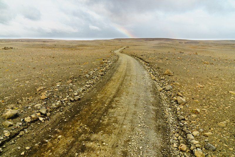 A dirt road and a rainbow a few hours from Reykjavik, Iceland.