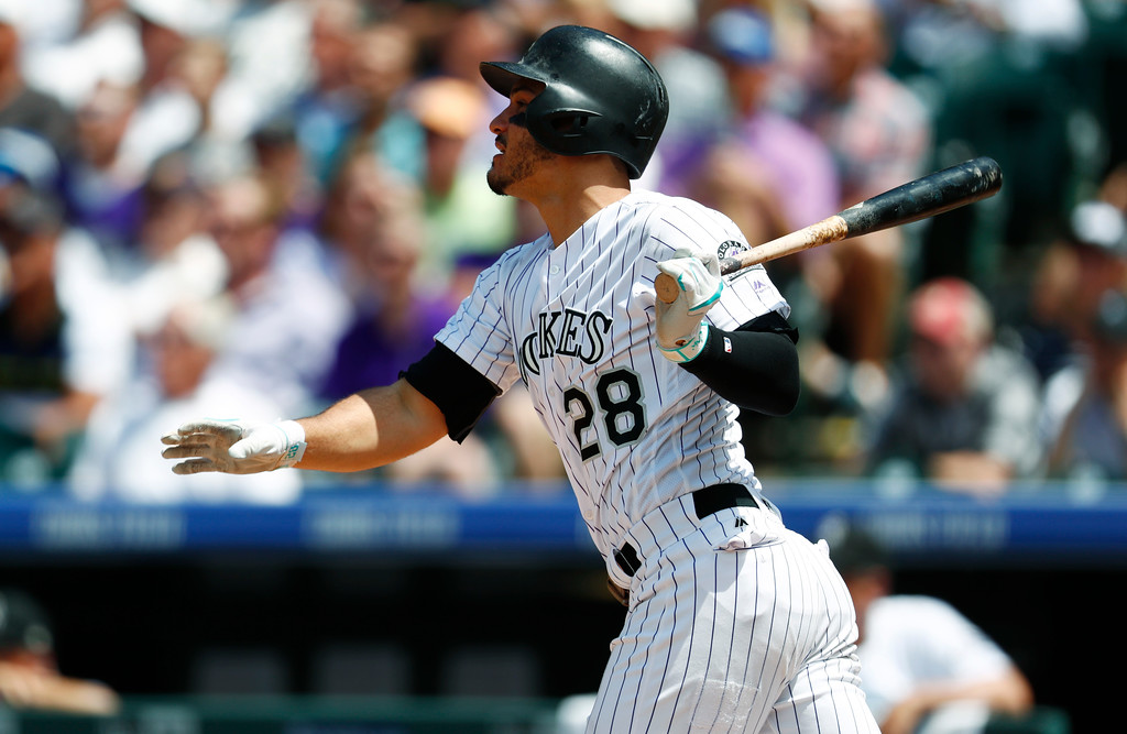 . Colorado Rockies\' Nolan Arenado watches his two-run double off Cleveland Indians starting pitcher Trevor Bauer during the third inning of a baseball game Wednesday, June 7, 2017, in Denver. Colorado won 8-1. (AP Photo/David Zalubowski)