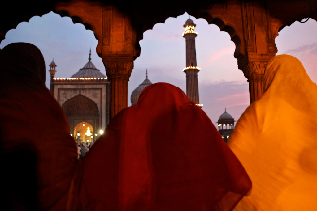. Muslim women pray at Jama Masjid on the eve of Eid al-Fitr in New Delhi, India,Thursday, Aug 8, 2013. Eid al-Fitr marks the end of the holy month of Ramadan, during which Muslims all over the world fast from sunrise to sunset. (AP Photo/Tsering Topgyal)
