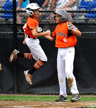 8/6/2019 Mike Orazzi | Staff Pennsylvania's Lucas Martz (22) and Aaron Angelo (6) after scoring during their second game of the Little League Mid-Atlantic regional on Aug. 6, 2019 at Breen Field in Bristol, Ct.