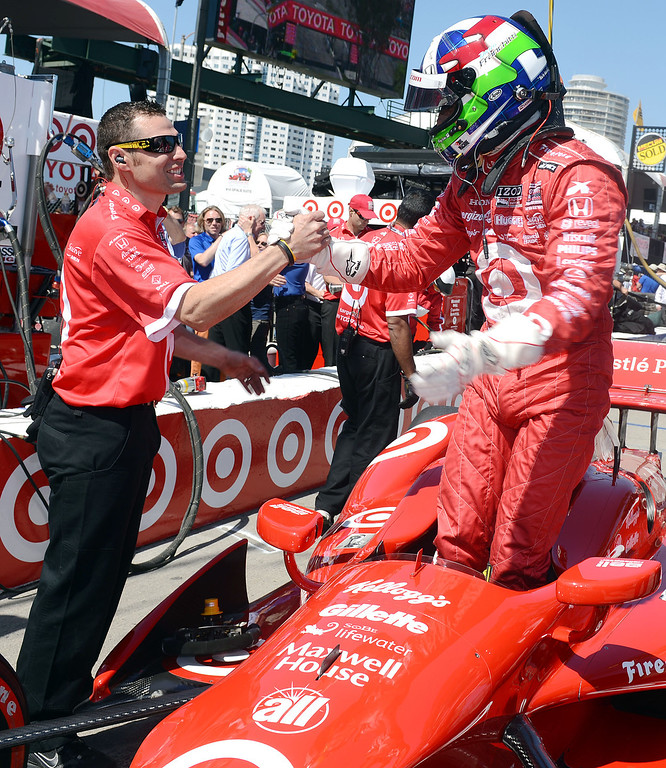 . (Will Lester/Staff Photographer)  Indycar driver Dario Franchitti celebrates with mechanic Nick Ford after winning the pole on the final lap of qualifying for Sunday\'s Toyota Grand Prix of Long Beach Saturday April 20, 2013 at the 39th annual Toyota Grand Prix of Long Beach.