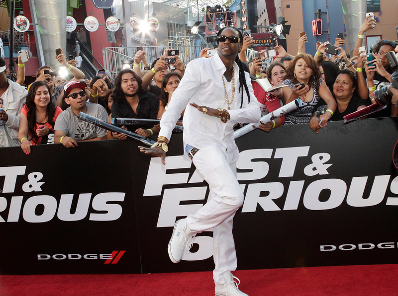 ". Rapper 2 Chainz greet fans as he arrives as a guest at the premiere of the new film, ""Fast & Furious 6\"" at Universal Citywalk in Los Angeles May 21, 2013. REUTERS/Fred Prouser"