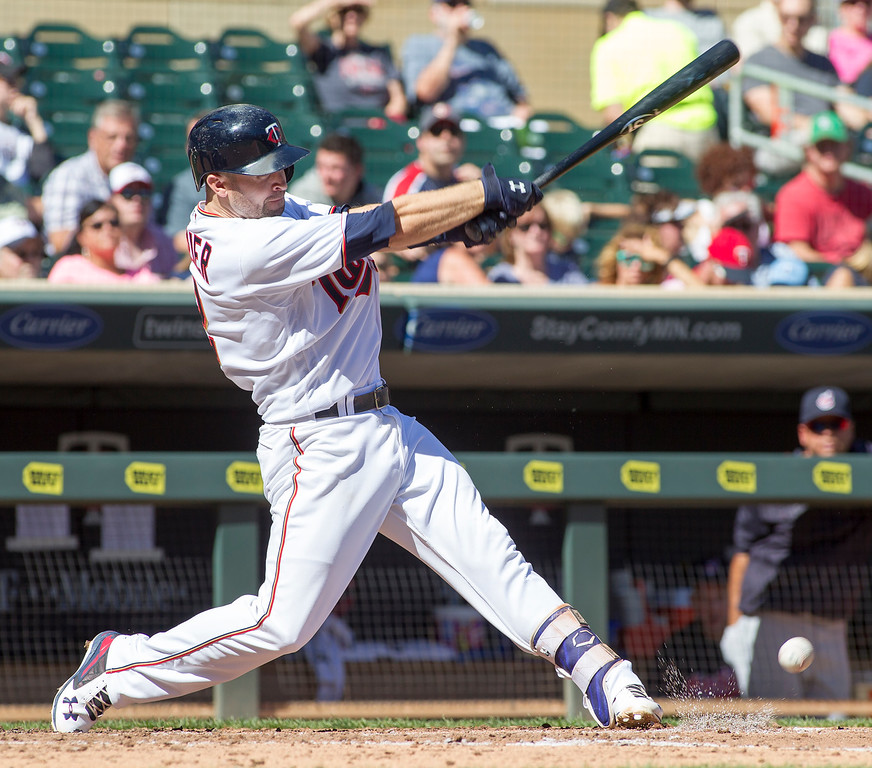 . Minnesota Twins Brian Dozier follow through on an infield single against the Cleveland Indians during the third inning of a baseball game, Sunday, Sept. 11, 2016, in Minneapolis. The Indians won 7-1. (AP Photo/Paul Battaglia)