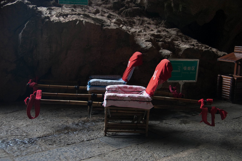 For those tourists who can't or are not inclined to walk up all the steps in the caves, they can't get a ride on these carriers for a mere $35 USD.