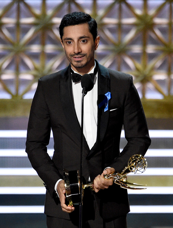 ". Riz Ahmed accepts the award for outstanding lead actor in a limited series or a movie for ""The Night Of\"" at the 69th Primetime Emmy Awards on Sunday, Sept. 17, 2017, at the Microsoft Theater in Los Angeles. (Photo by Chris Pizzello/Invision/AP)"