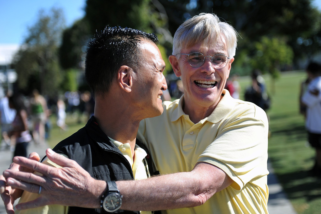 . Jeff Brue, left, and Tom Coates, who hope to get married, attend a rally in West Hollywood to celebrate the U.S. Supreme Court\'s ruling that killed Prop 8, Wednesday, June 26, 2013. (Michael Owen Baker/L.A. Daily News)