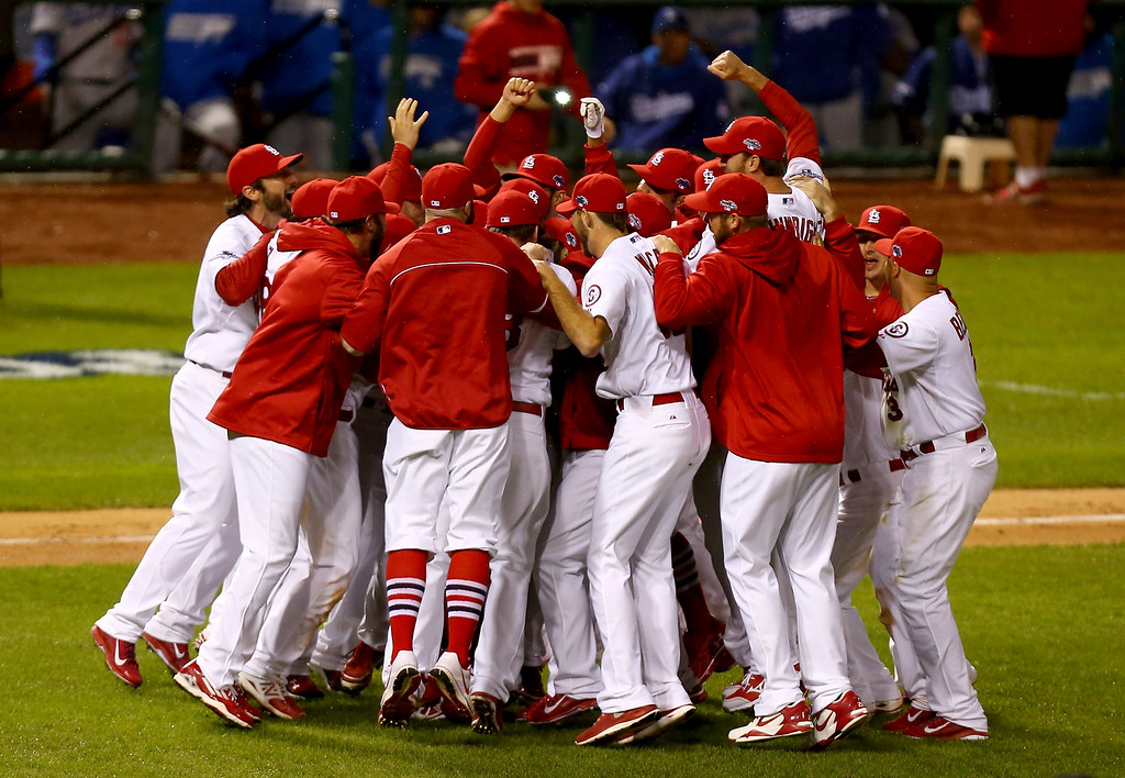 . ST LOUIS, MO - OCTOBER 18:  The St. Louis Cardinals celebrate after defeating the Los Angeles Dodgers 9-0 in Game Six of the National League Championship Series at Busch Stadium on October 18, 2013 in St Louis, Missouri.  (Photo by Ed Zurga/Getty Images)