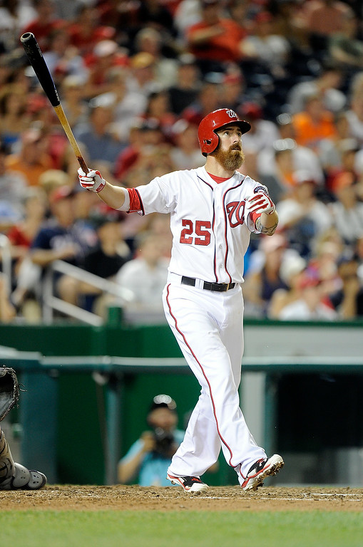 . WASHINGTON, DC - JUNE 30: Adam LaRoche #25 of the Washington Nationals hits a home run in the seventh inning against the Colorado Rockies at Nationals Park on June 30, 2014 in Washington, DC.  (Photo by Greg Fiume/Getty Images)